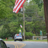 DeMott Lane Flag Mystery Solved: It's All About The Money