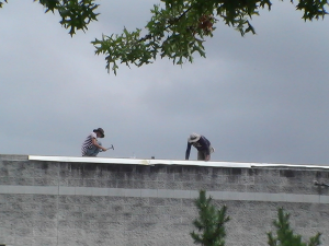 Construction workers on the Police Department roof.